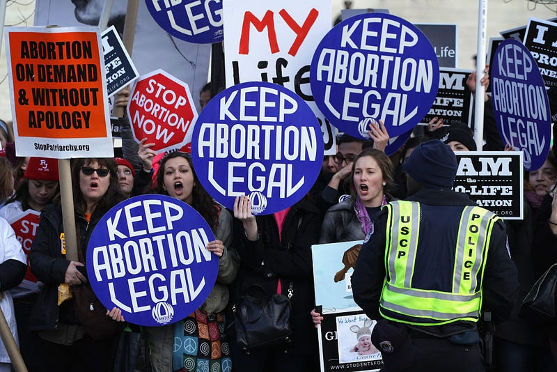 Pro-choice activists shout slogans before the annual March for Life passes by the U.S. Supreme Court  in Washington, D.C., on Jan. 22, 2015. Alex Wong/Getty Images
