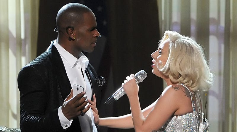 Singers R. Kelly (L) and Lady Gaga perform onstage during the 2013 American Music Awards on November 24, 2013 in Los Angeles, California.