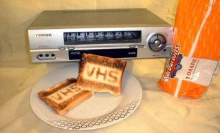 Illustration for article titled VHS Toaster Eats Breakfast, Not Tapes