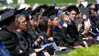 Members of the University of California, Merced, Class of 2009 listen as first lady Michelle Obama delivers the commencement speech on May 16, 2009.David Paul Morris/Getty Images