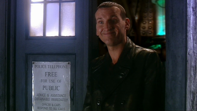 "Christopher Eccleston at the end of ""Rose""—a story in which he's now not the only Doctor to show up in, thanks to a new novelization."