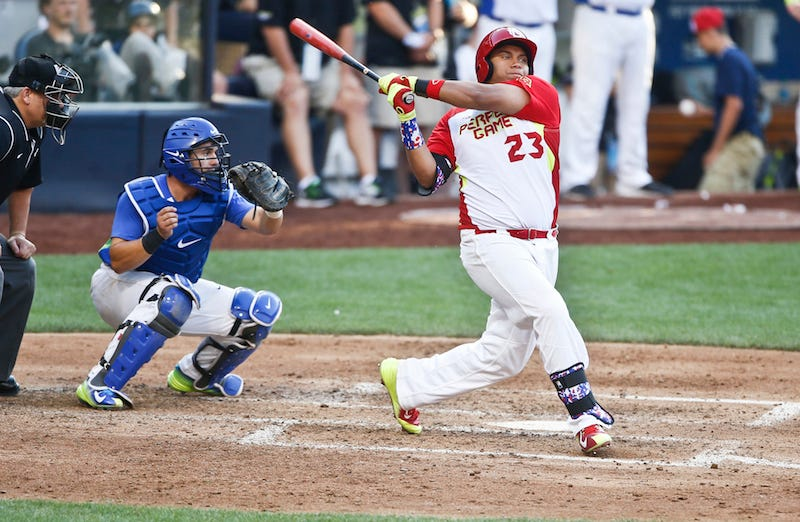 Josh Naylor bats in a 2014 high school all-star baseball game. Photo: AP