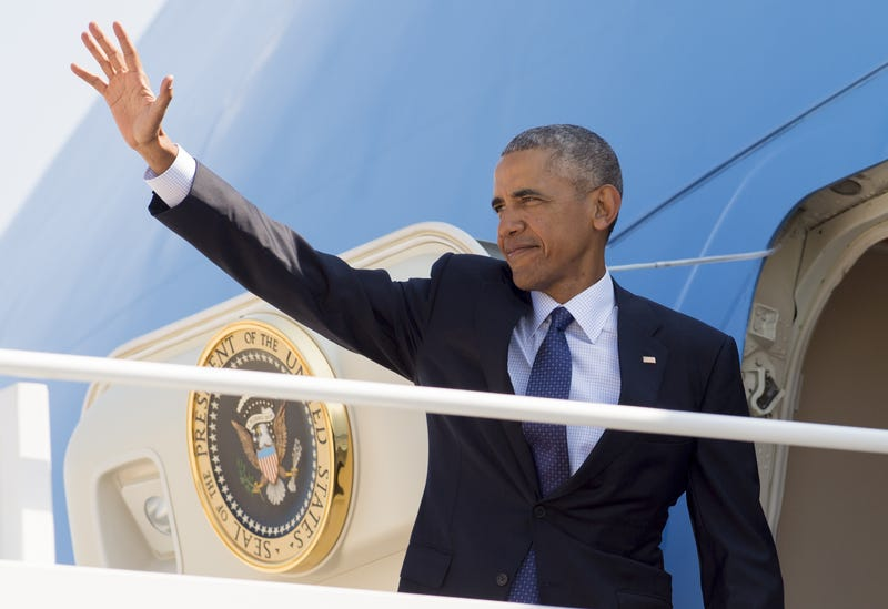 President Barack Obama waves from Air Force One prior to departing from Andrews Air Force Base in Maryland on Aug. 31, 2016. SAUL LOEB/AFP/Getty Images