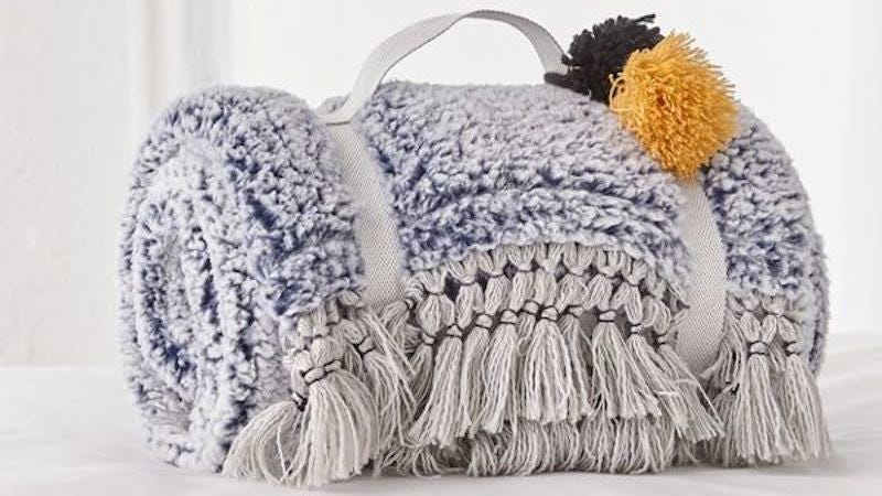 Amped Fleece Fringe Trim Throw Blanket | $50 | Urban Outfitters