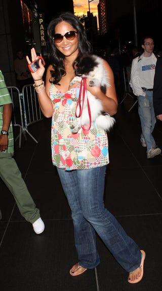 Illustration for article titled Kimora Lee Simmons: Phone, Flip-Flops, Furry Friend