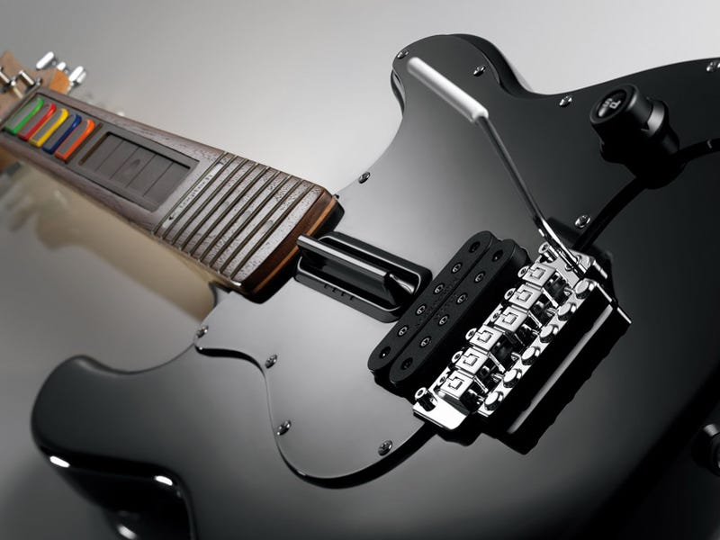 Illustration for article titled Logitech Wireless Guitar Controller For PS3/PS2 Hands On