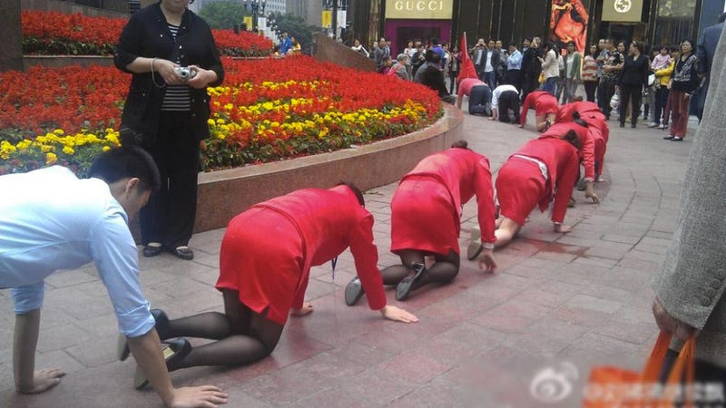 Illustration for article titled Chinese Employees Made To Crawl in Public