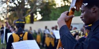 People in the Soweto township of Johannesburg sing songs in Mandela's honor. (Getty Images)