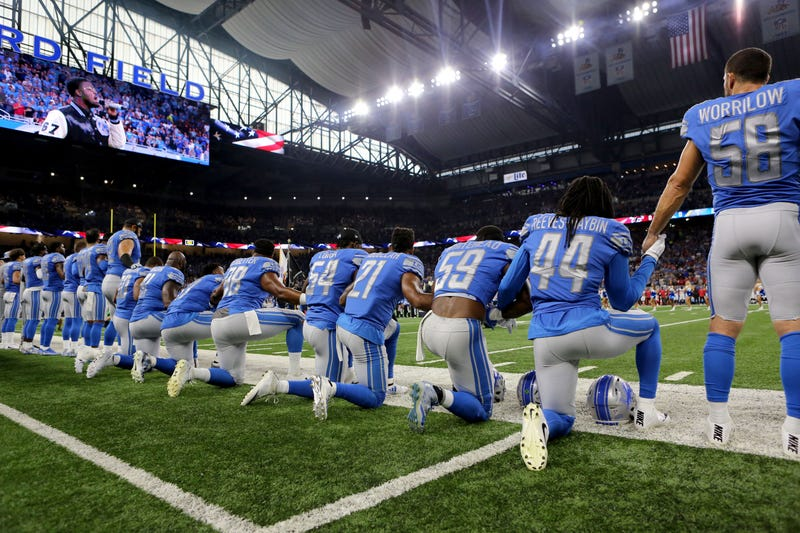 Members of the Detroit Lions take a knee during the playing of the national anthem prior to the start of the game Sept. 24, 2017, in Detroit. (Rey Del Rio/Getty Images)