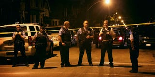 Chicago police officers respond to a shooting. (Getty Images)