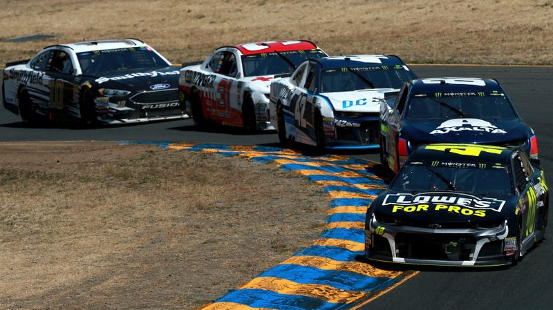 Each car except for the Stewart-Haas No. 10 of Aric Almirola runs a fixed wiper in the sun in a photo from the Monster Energy NASCAR Cup Series race at Sonoma in June.