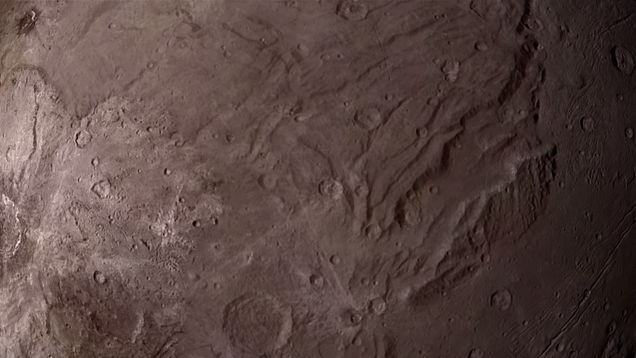 Soar Over The Surface Of Pluto's Moon In This Close-Up Flyover Video