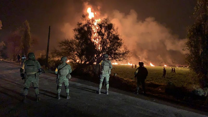 Soldiers survey the scene of a massive gas explosion in Tlahuelilpan, Hidalgo state, Mexico, on Jan. 18, 2019.