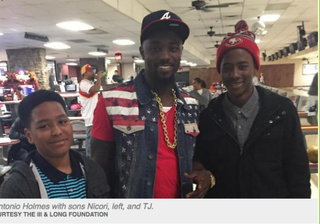 Santonio Holmes with sons Nicori, left, and T.J.Courtesy of the III & Long Foundation