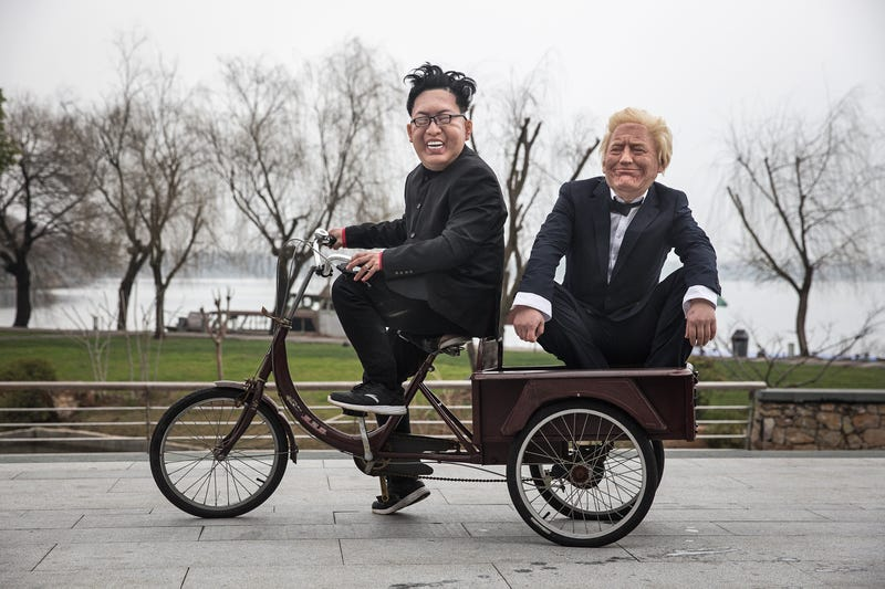 Models wearing masks made by sculptural artist Zhangzhen 33 of US President Donald Trump and Supreme Leader of North Korea Kim Jong-un seen on February 20, 2019 in Wuhan, China.