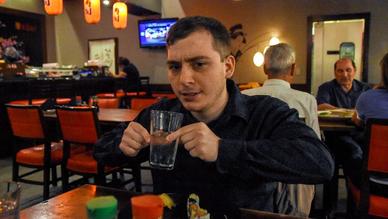 Illustration for article titled Self-Conscious Man Clearly The Only One In Japanese Restaurant Unsure How To Use Water Glass