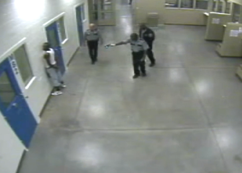 Video footage shows Carlos Seals standing up facing a wall with his hands behind his back when officers shock him with Tasers.WSB-TV