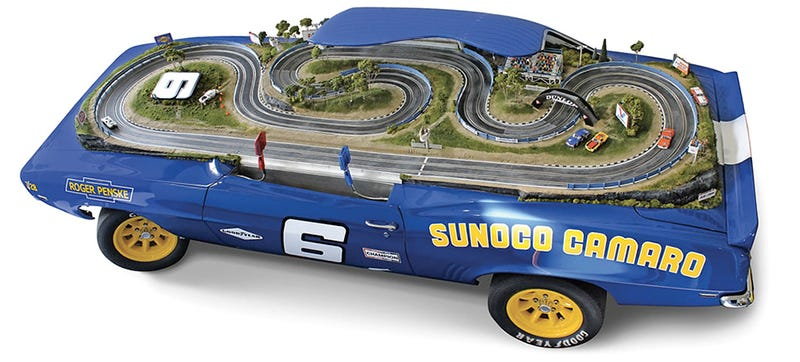 Illustration for article titled A 1969 Camaro Z/28 Reborn as an Incredibly Detailed Slot Car Track