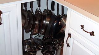 Hang Pots and Pans in Corner Cabinets to Make Better Use of Them