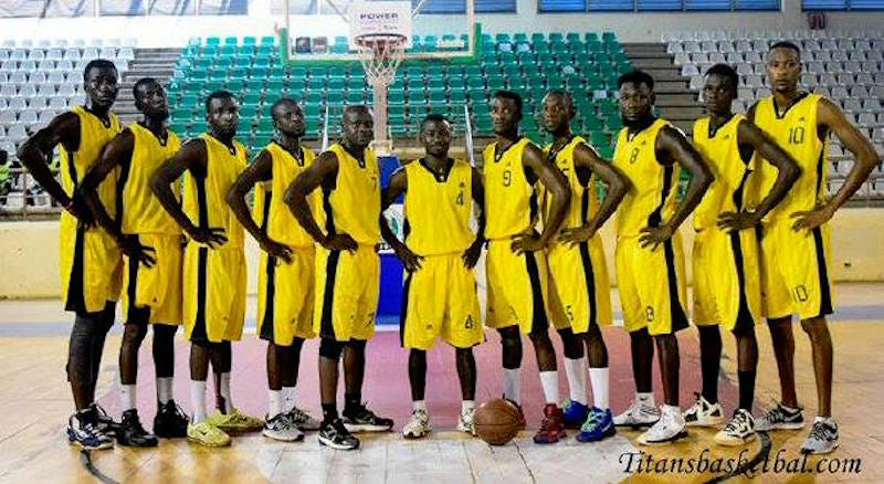 Jimmy Sorunke, far left, poses with the Ogun Pacers of the NBBF, a Nigerian professional league, before a national tournament in 2016.