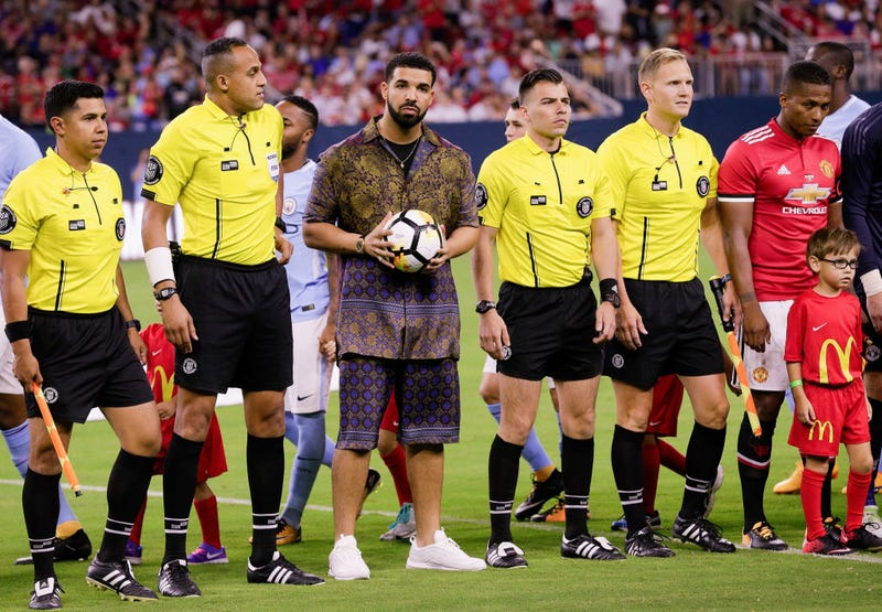 Drake brings out the game ball with the officials at the international Champions Cup 2017 match between Manchester United and Manchester City at NRG Stadium on July 20, 2017, in Houston.