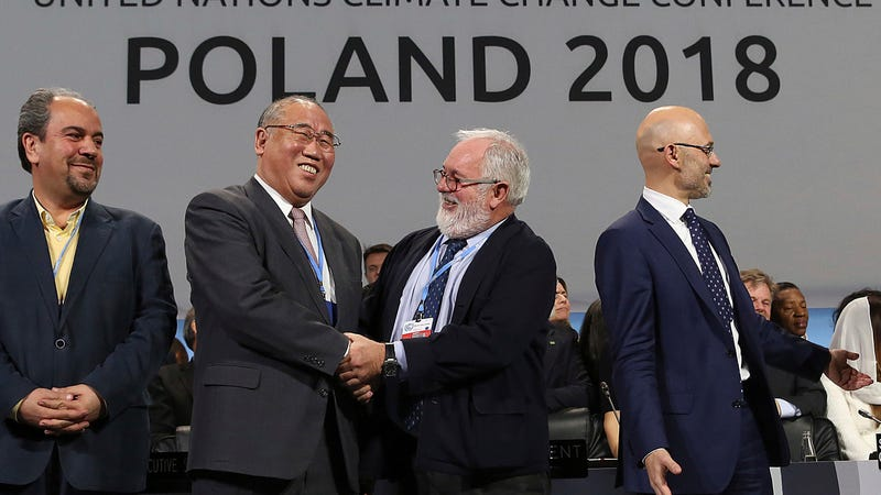 Heads of delegations cheer an end to a grueling series of climate negotiations in Katowice.