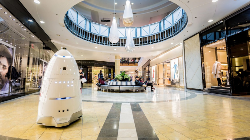 Knightscope's K5 bot patrolling a mall.