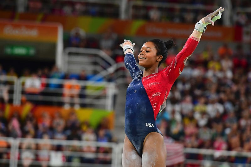 Gymnast Gabby Douglas competes in the qualifying event for the women's uneven bars during the Rio 2016 Olympic Games in Rio de Janeiro on Aug. 7, 2016.EMMANUEL DUNAND/AFP/Getty Images