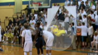 Two students from Holy Spirit High School in New Jersey dressed as a monkey and a banana when their team took on the mostly black Atlantic City High School team.NBC 10 Screenshot