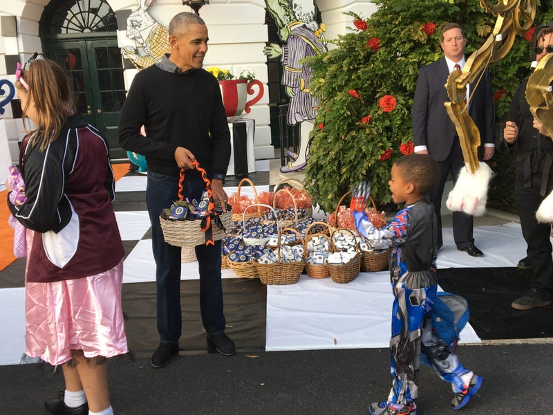 Robeson Perry, 5, with President Barack Obama, at Trick or Treat at the White House on Oct. 31, 2016Andre Perry