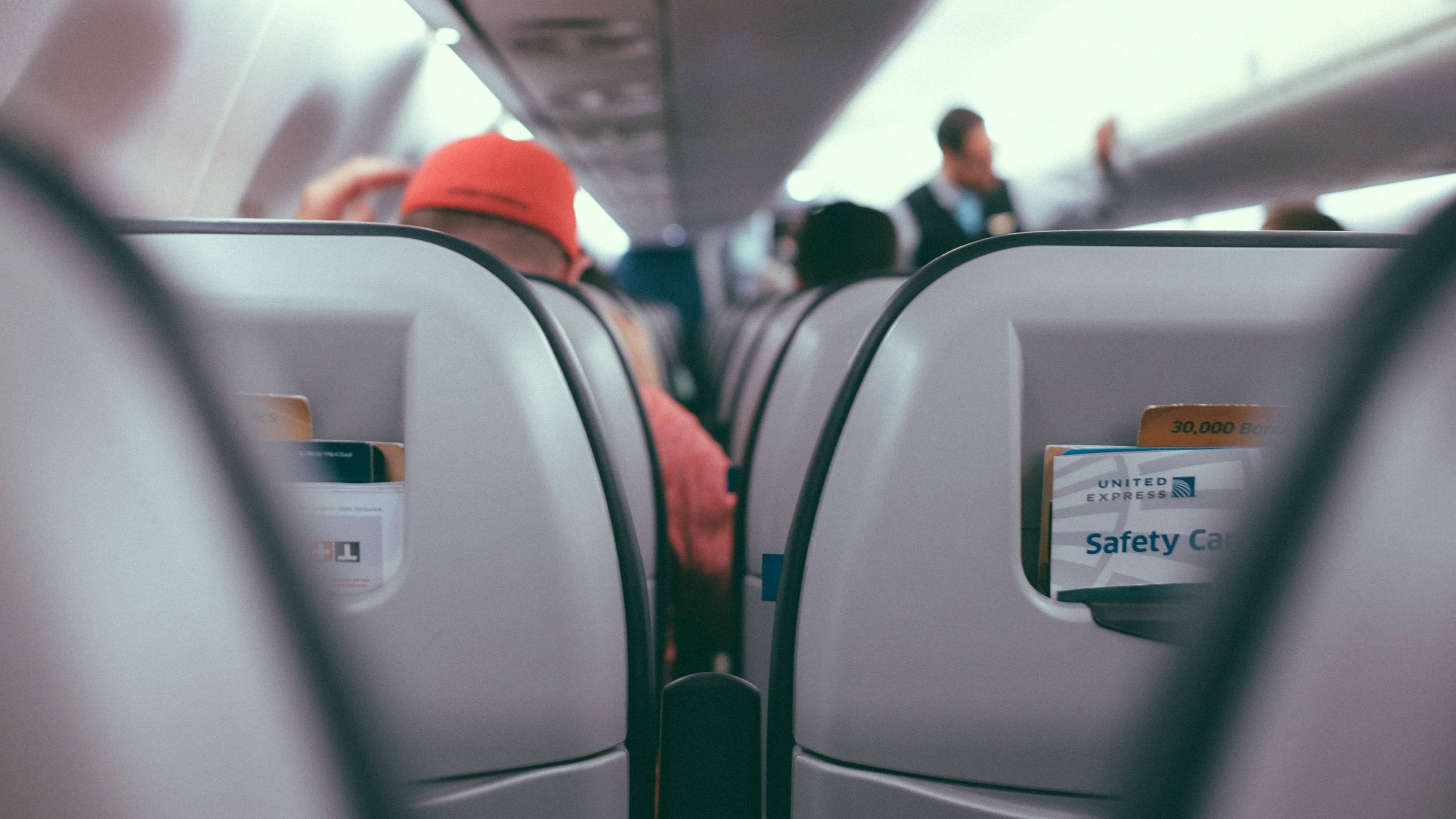 Before You Recline Your Aeroplane Seat, Check The Person Behind You