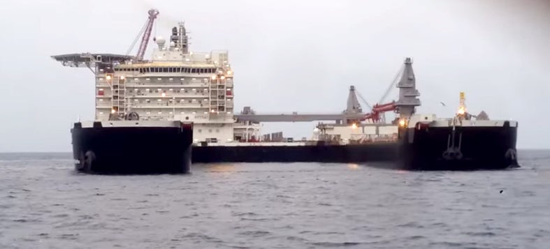 This is now Earth's largest ship -- so big it can lift oil rigs off the sea