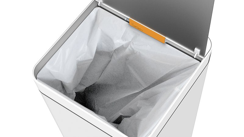 A Garbage Can With a Vacuum Just Made Dustpans Obsolete