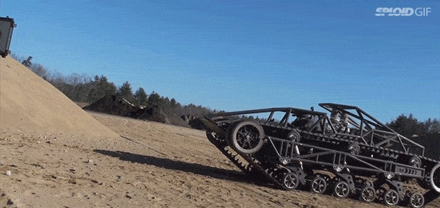 Crazy Mad Max car shows how bad arse it is by scaling a sand wall
