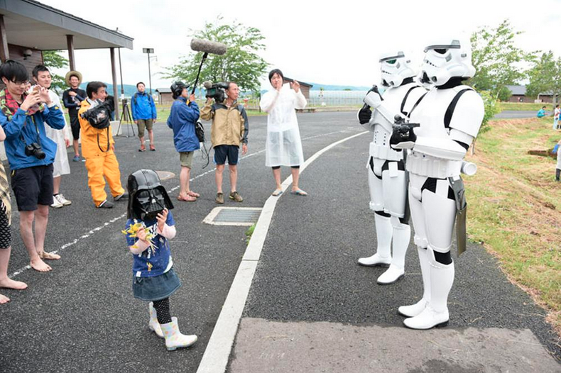 Stormtroopers Make Sure Japanese Children Plant Rice