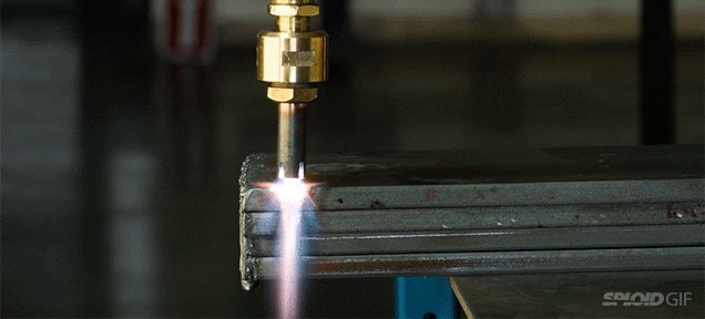 Watch an oxy-gasoline liquid fuel torch cut through metal