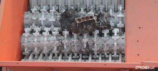 Watch a humongous hungry machine crush and swallow engine blocks