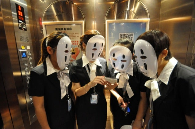 Chinese Employees Relieve Stress with Studio Ghibli Masks