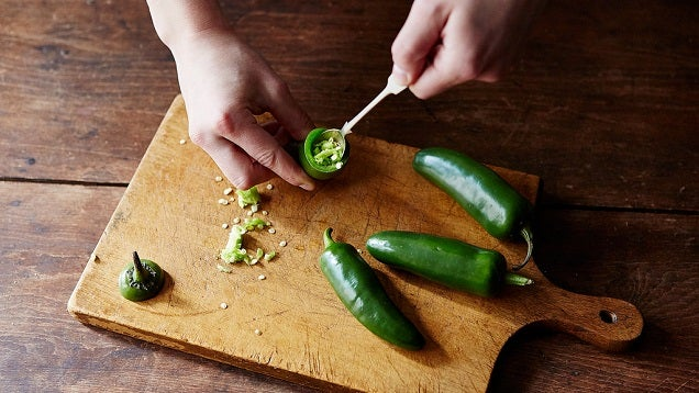 Quickly And Safely Seed A Chilli Pepper With A Small Spoon