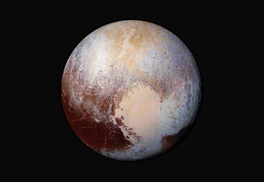 Pluto Looks Dazzling in This New Exaggerated Colour Image