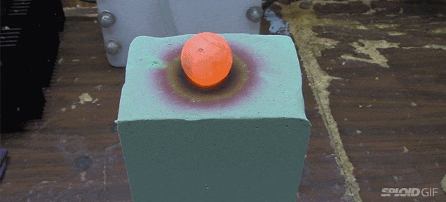 Red hot nickel ball burning through foam breaks the colour spectrum