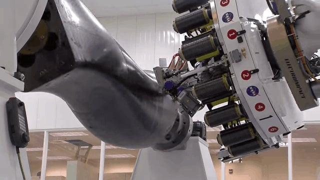 This Robot Is a Loom For Weaving Carbon Fibre Into Rocket Parts