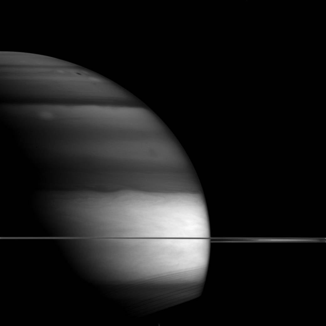 Saturn Looms Eerily in Infrared