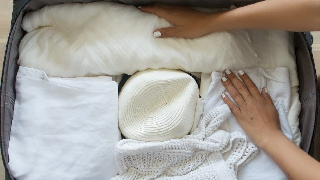 The Best Way to Pack a Fancy Hat In a Suitcase So It Doesn't Get Crushed