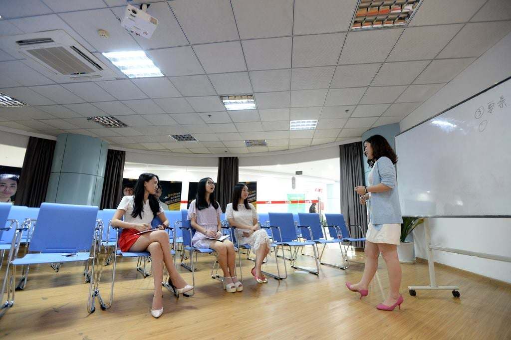In China, Women Hired To Motivate Computer Programmers