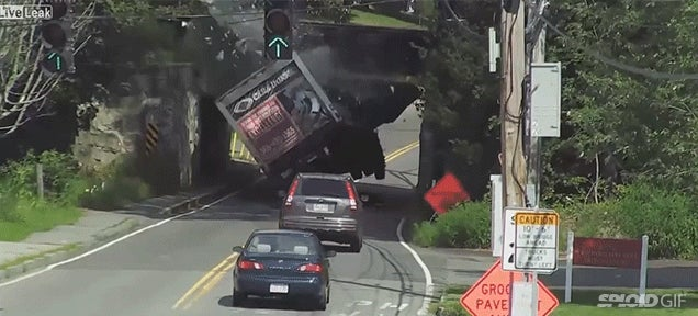 Truck gets obliterated when it runs into the bottom of a bridge