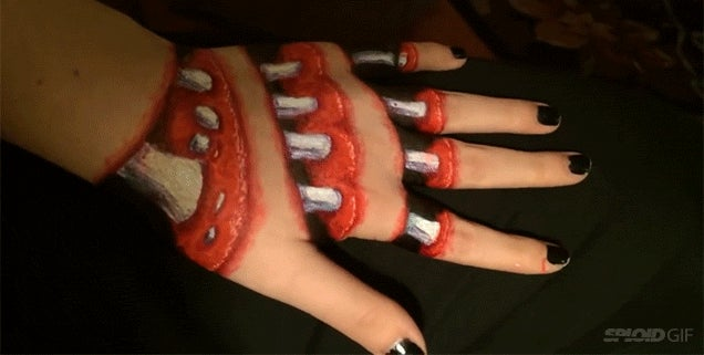 Creepy body painting makes it look like you can see the guts and bones of a hand