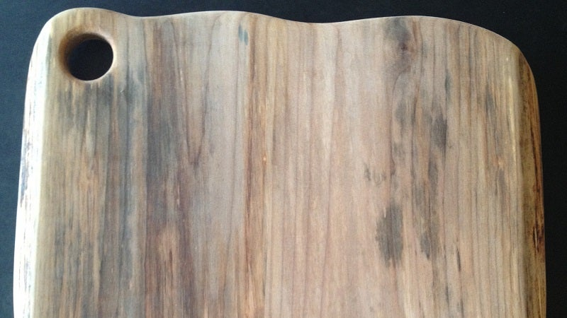 Fix a Warped Wood Cutting Board With a Damp Cloth and an Iron