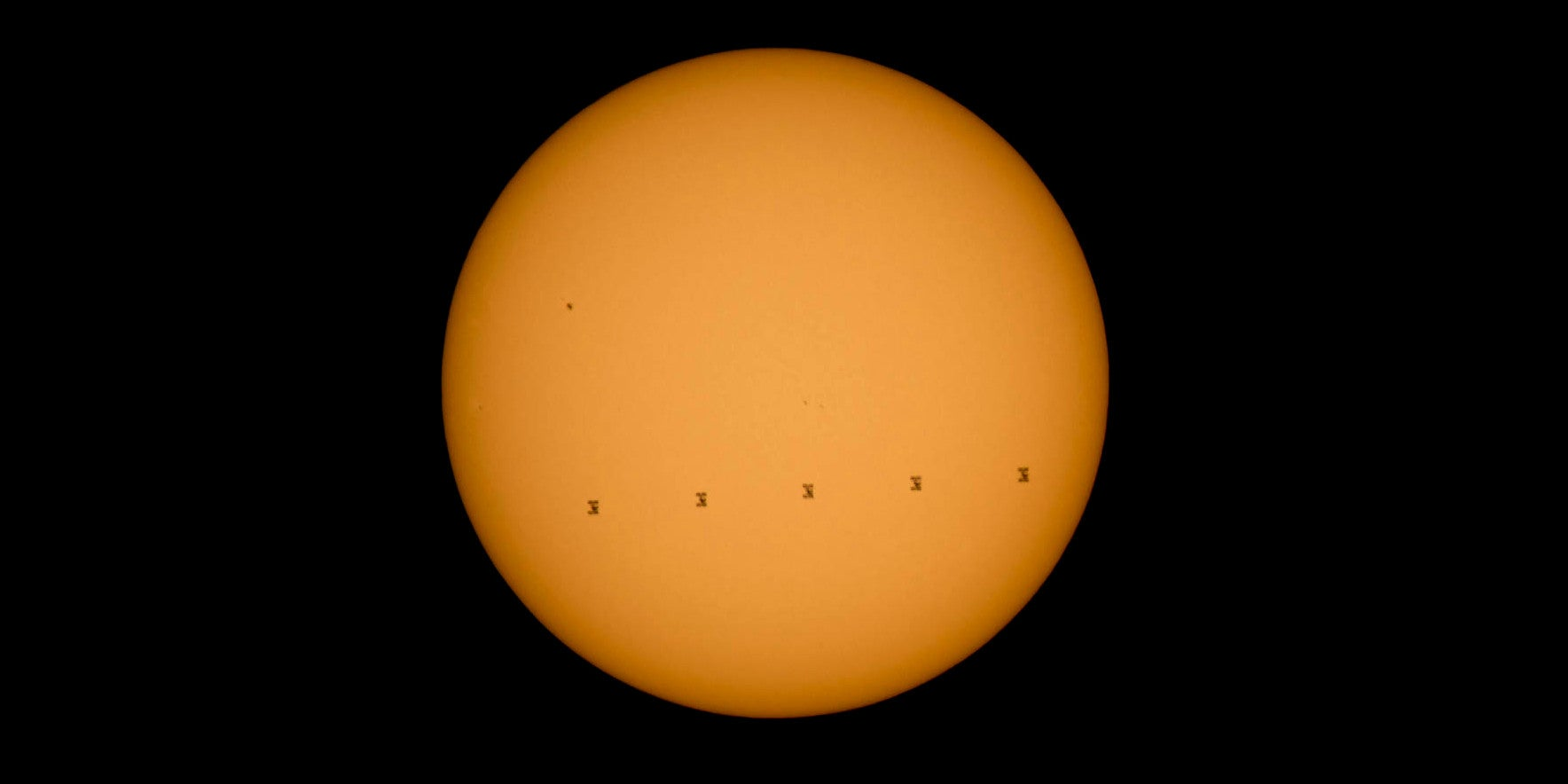 A Beautiful Composite Image of the ISS Crossing the Sun