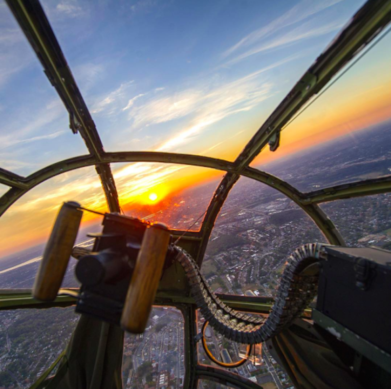 Awesome view of a sunset through the nose of an old B-25 bomber